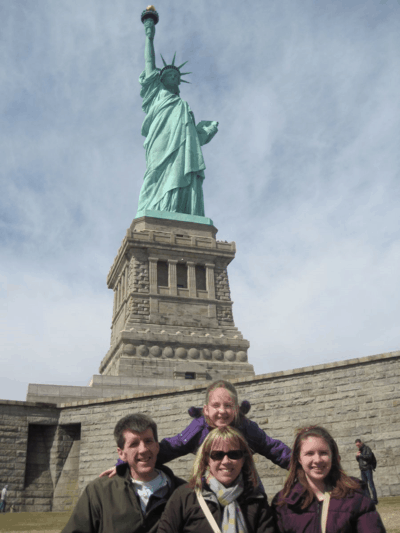 new york city-family at statue of liberty