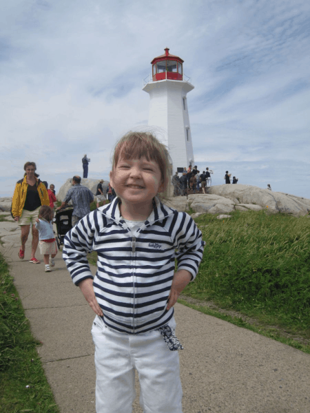 nova scotia-peggy's cove-young girl at lighthouse