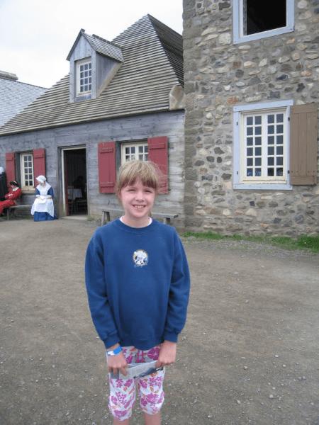 nova scotia-cape breton island-girl at fortress of louisburg
