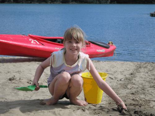 chateau montebello-kenauk-whitefish lake-playing on beach