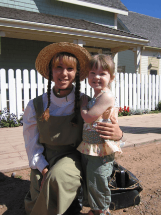prince edward island-avonlea village-young girl with anne of green gables