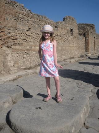 italy-pompeii-girl on stepping stone