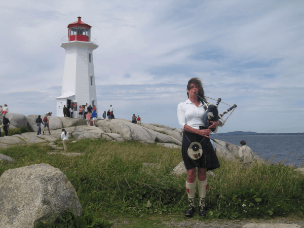 Nova Scotia-Bagpipe player at Peggy's Cove