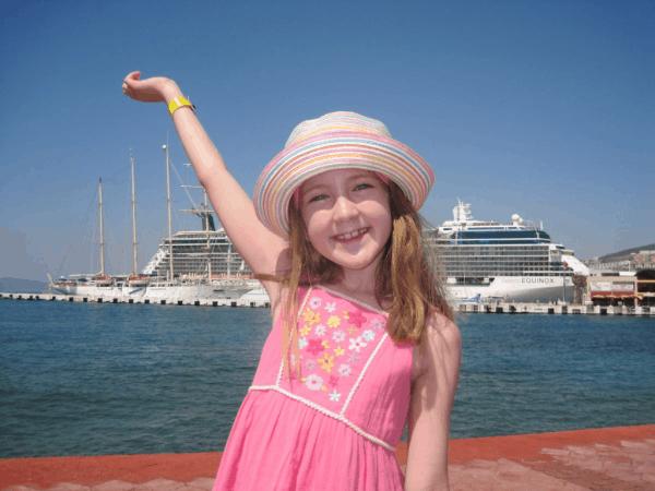 Turkey-Kusadasi-girl posing in front of Celebrity Equinox