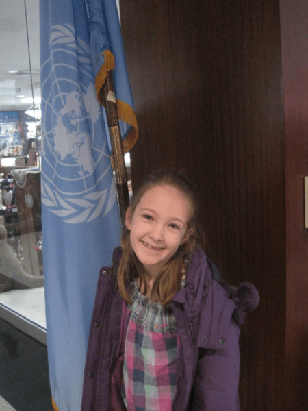 Emma with UN flag, New York City