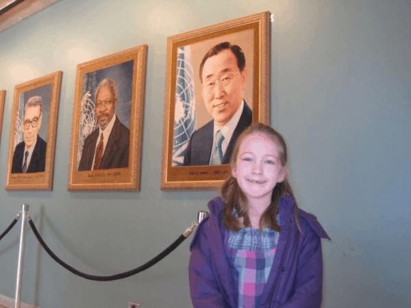 New York City-UN Headquarters-girl with portraits of Secretaries General of the UN