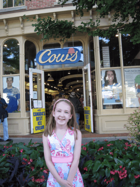 Emma outside COWS Ice Cream in Niagara-on-the-Lake