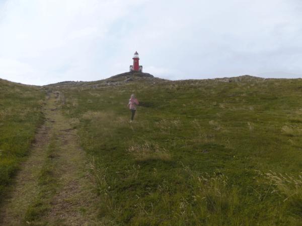 Newfoundland-Ferryland Lighthouse-girl running