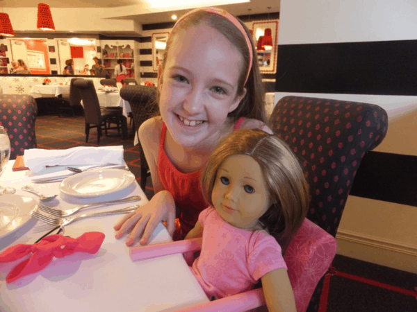 American Girl Cafe Chicago-girl dining with doll