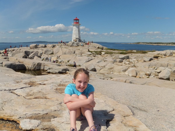 Nova scotia-peggy's cove-girl seated on rocks