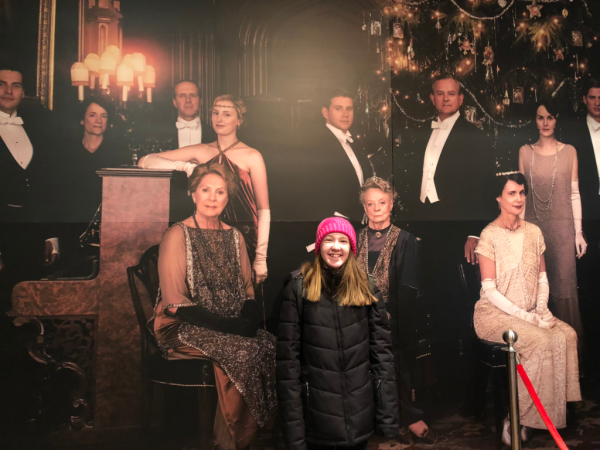 New york city-downton abbey exhibition-girl with portrait of Crawley family