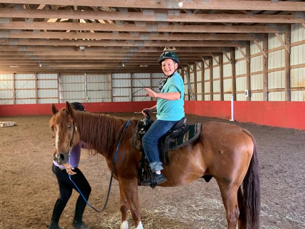 Newport Equestrian Academy-Newport RI-boy on horse in stable
