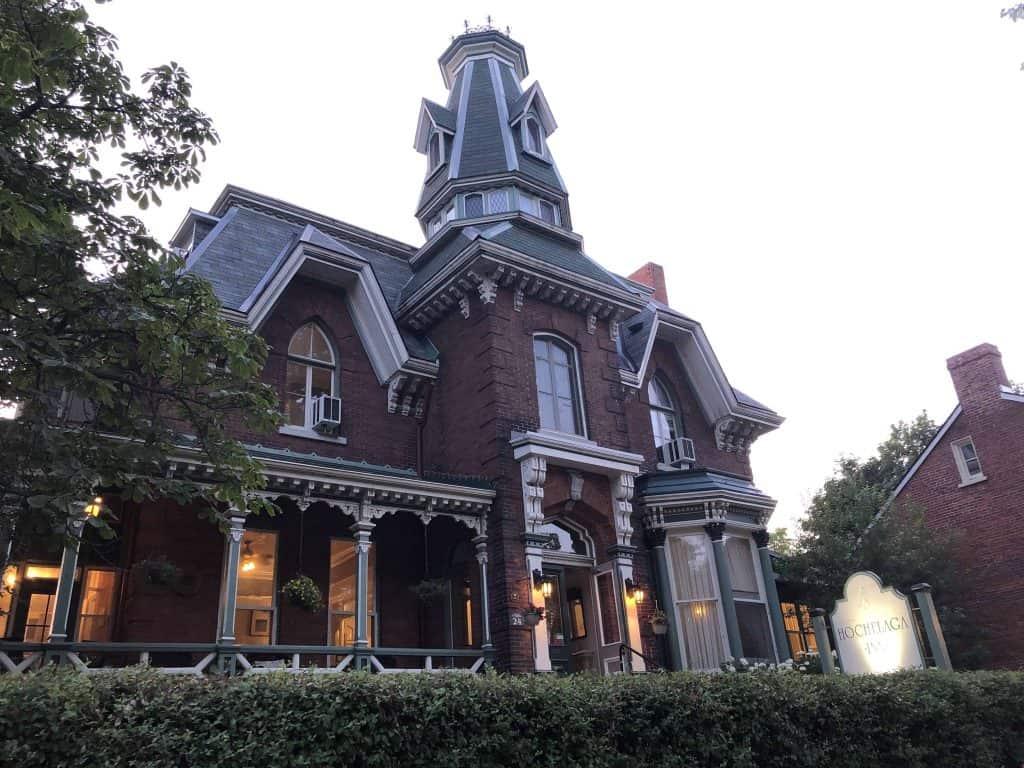 exterior of Victorian-style Hochelaga Inn at dusk