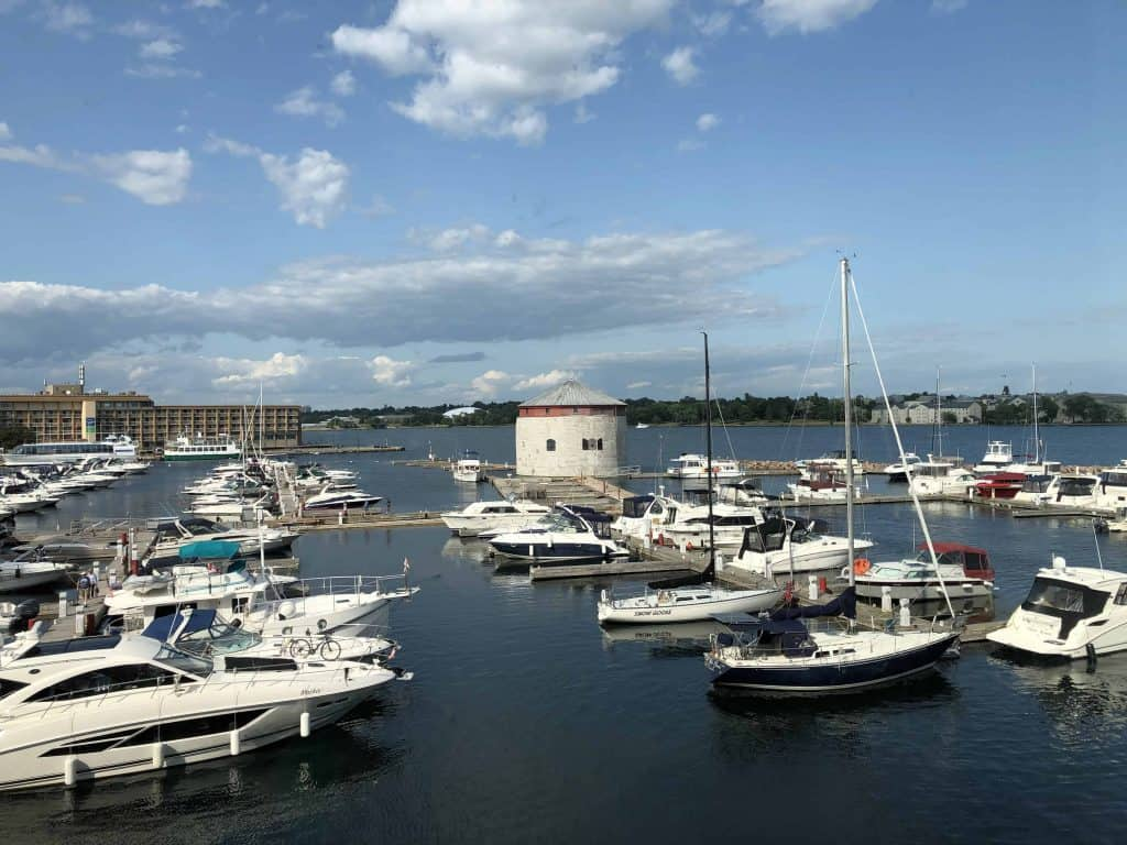 view of kingston waterfront with boats and martello tower
