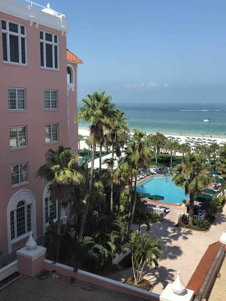 View of ocean and swimming pool from room at pink hotel