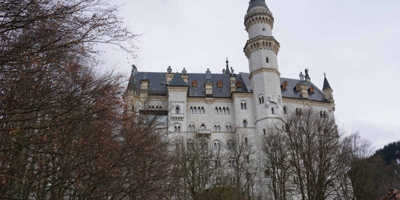 exterior of neuschwanstein castle germany early spring with bare trees