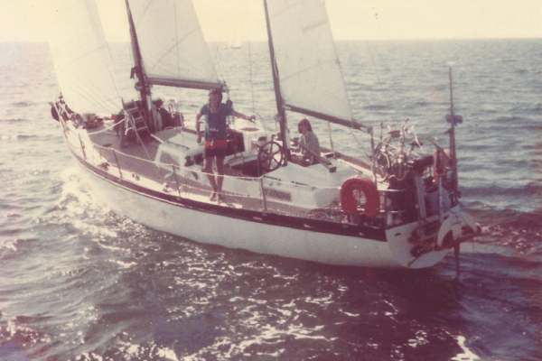 sail boat with family on ocean