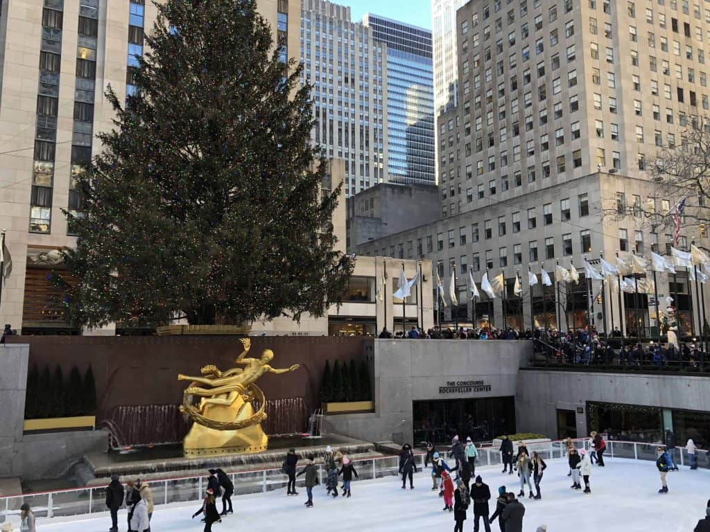 skating at rockefeller plaza with christmas tree