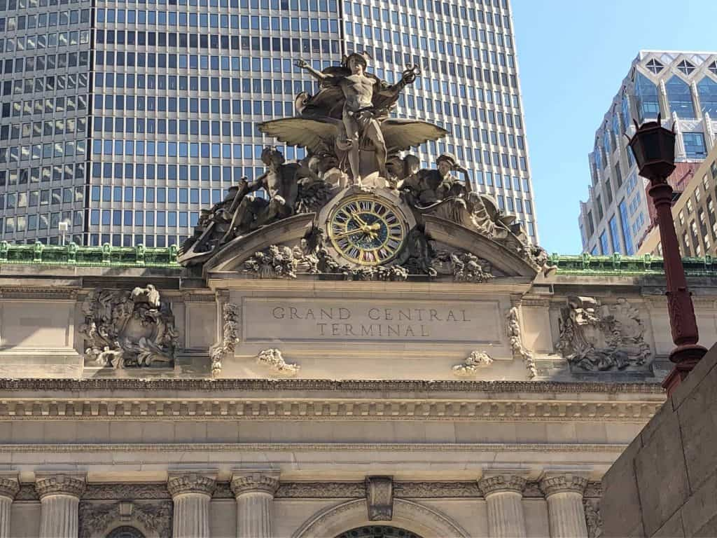 clock face and sculpture on exterior of grand central terminal