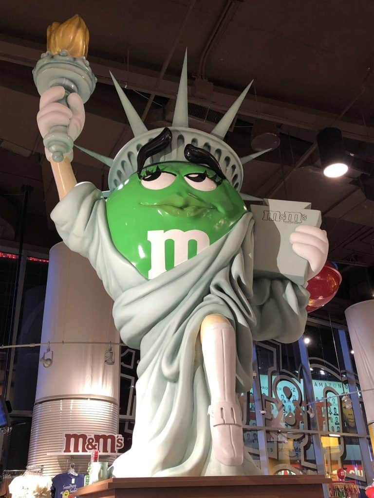 green m&m dressed as statue of liberty