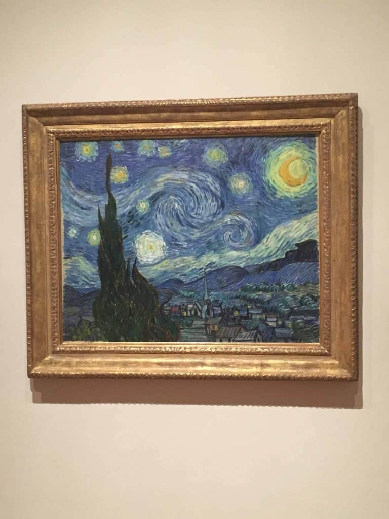van gogh starry night painting hanging on wall