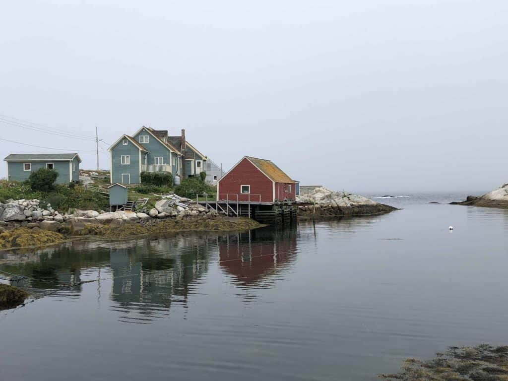 nova scotia lighthouse route-peggy's cove-colourful homes reflected in harbour