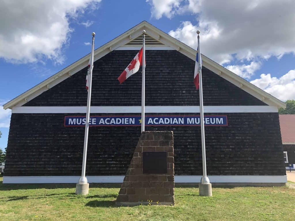 Acadian Museum with flags out front - prince edward island north cape coastal drive