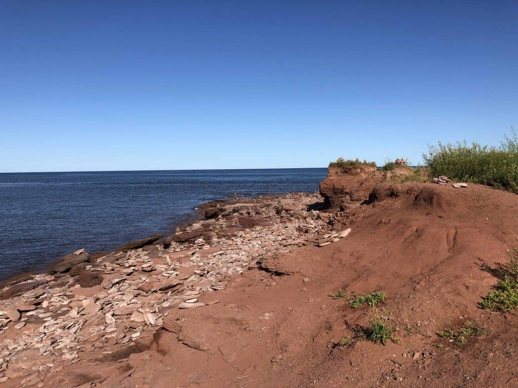 red sand and rocky beach - north cape prince edward island