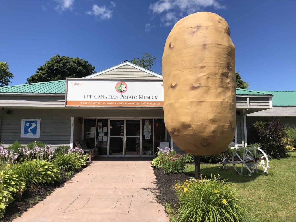large sculpture of potato outside entrance to The Canadian Potato Museum - prince edward island north cape coastal drive
