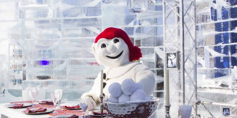 bonhomme snowman in red hat at dining table in ice castle