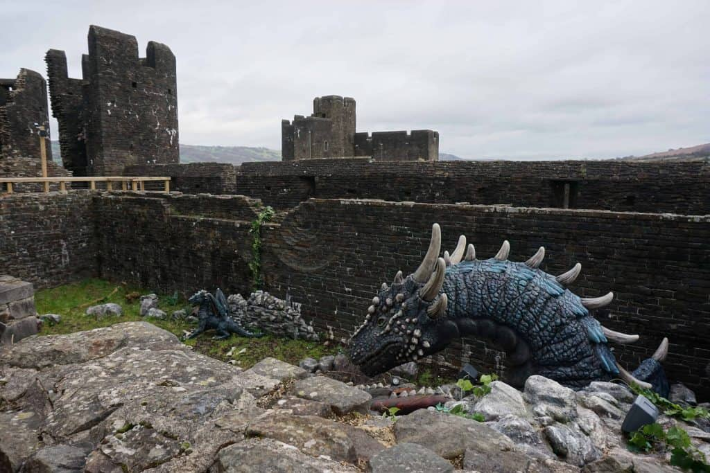 dragon sculpture at ancient stone castle