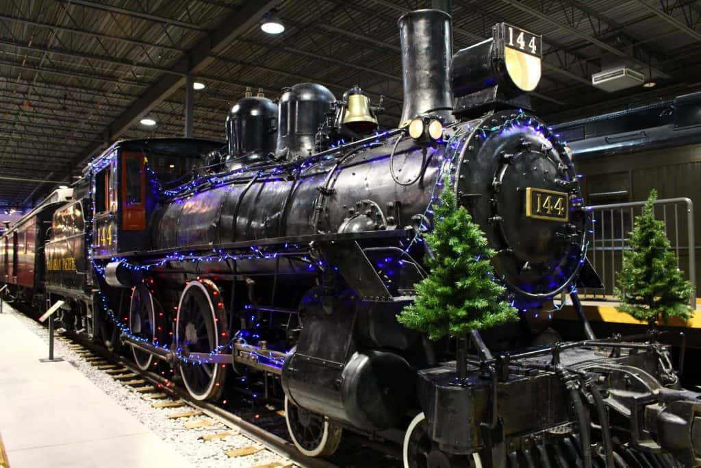 train in museum with christmas trees