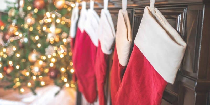 red and white christmas stockings hanging