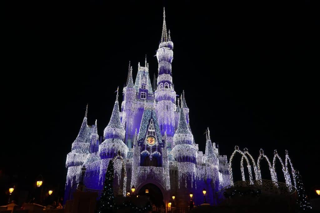 cinderella's castle at night covered with lights-disney world
