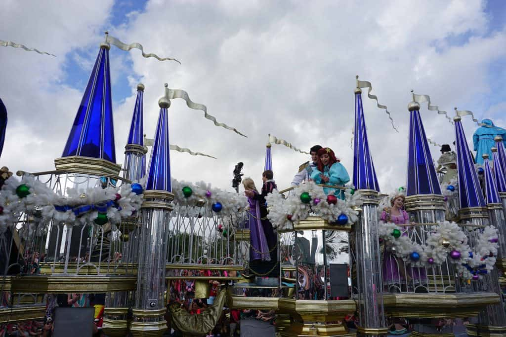 christmas float with princes and princesses at disney world
