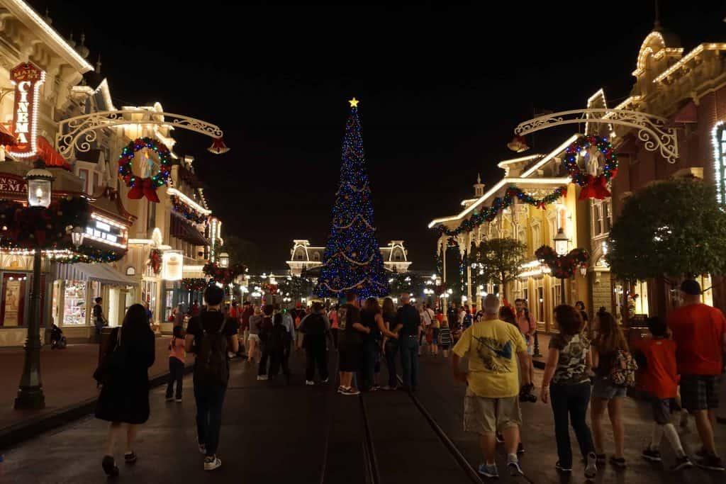 disney world-people walking on main street after dark-christmas