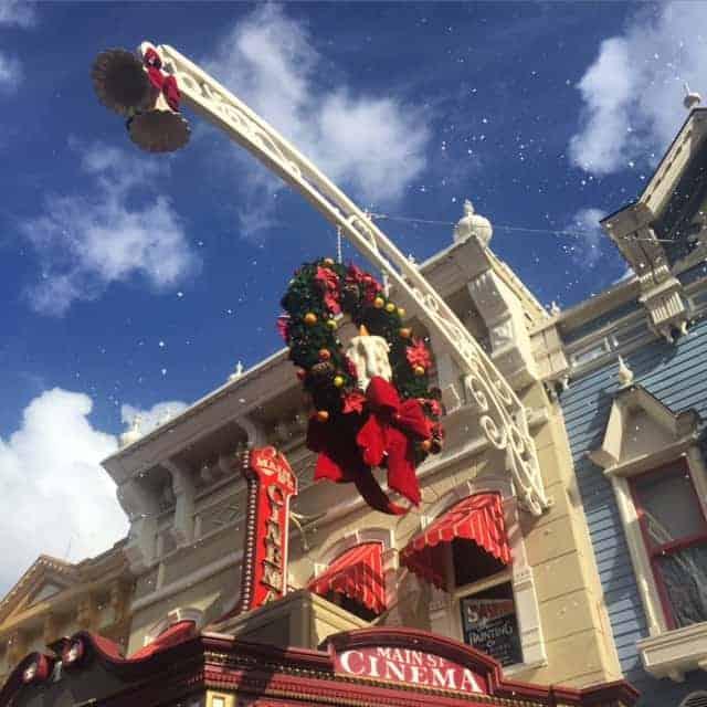snow around building with wreath-main street usa-disney world at christmas