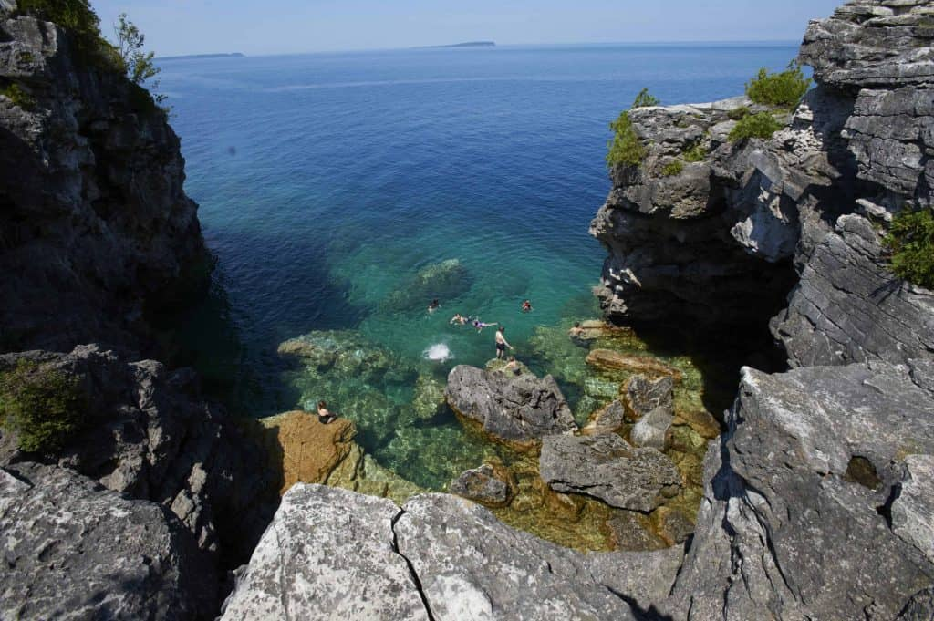 swimmers in blue grotto-bruce peninsula national park-ontario