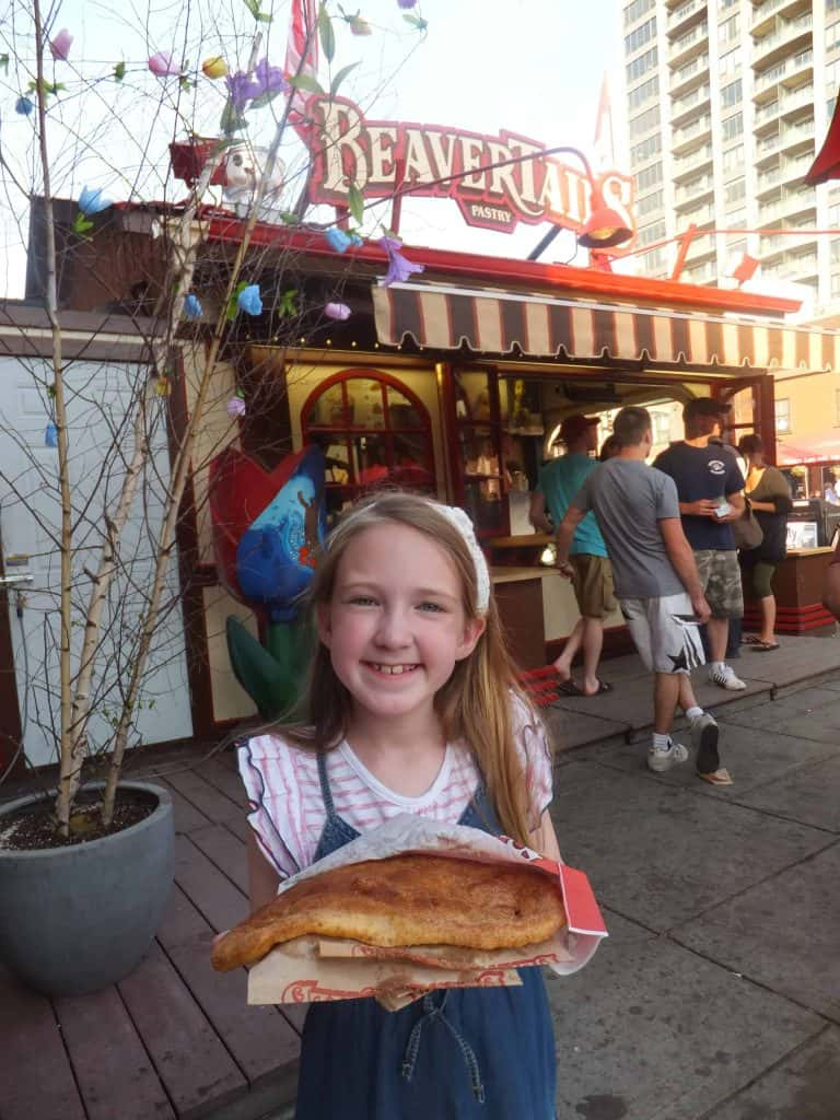 girl with BeaverTail-byward market-ottawa