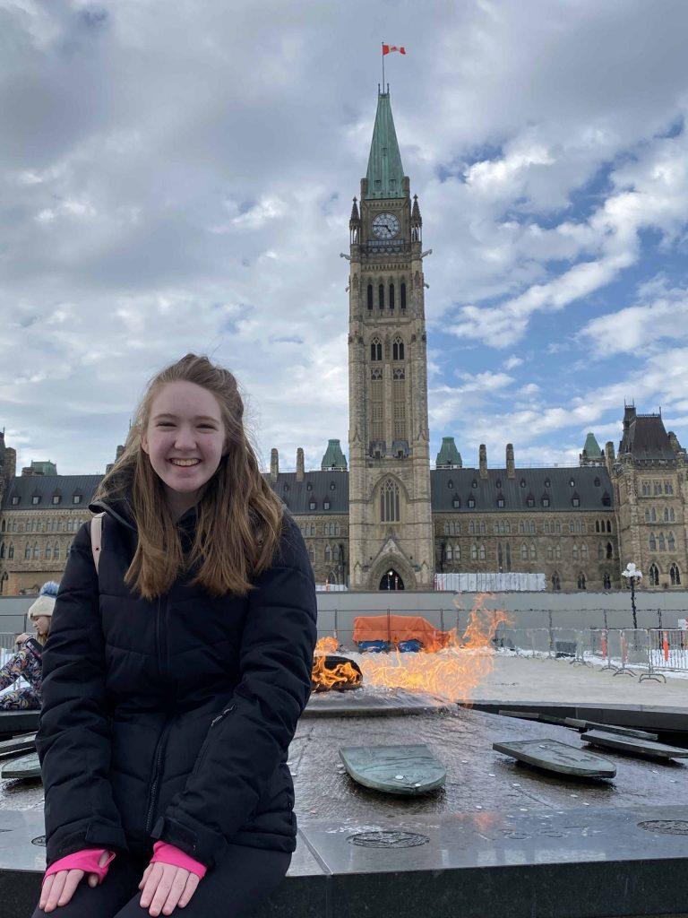 ottawa-parliament hill-young woman at centennial flame